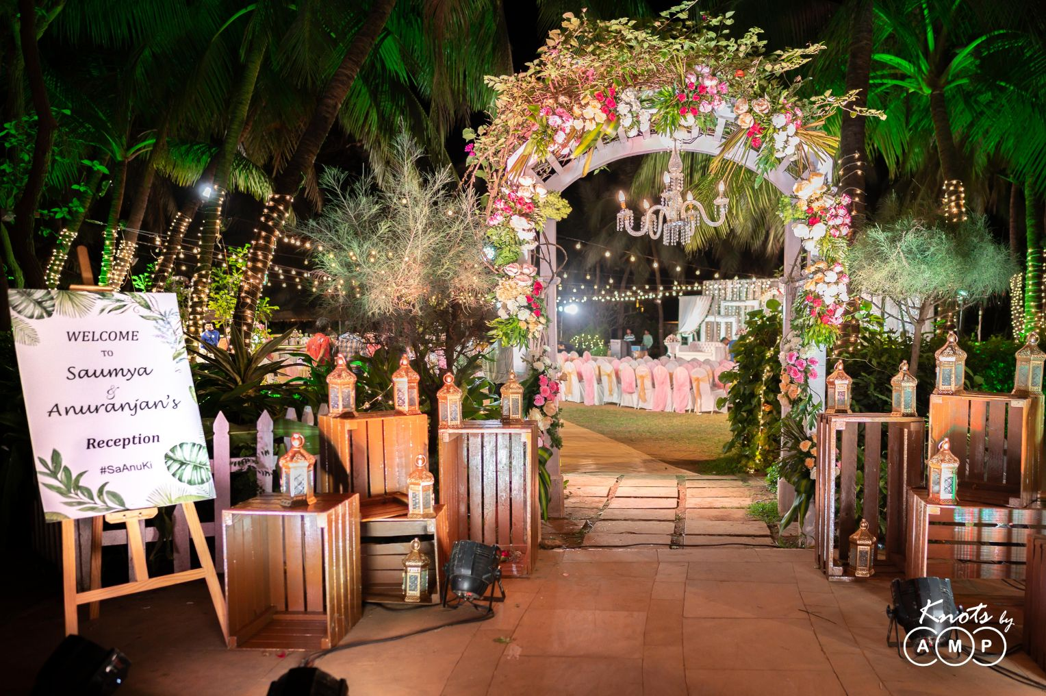 Beautiful Floral Reception Entrance Decor with Lanterns and Welcome Signage