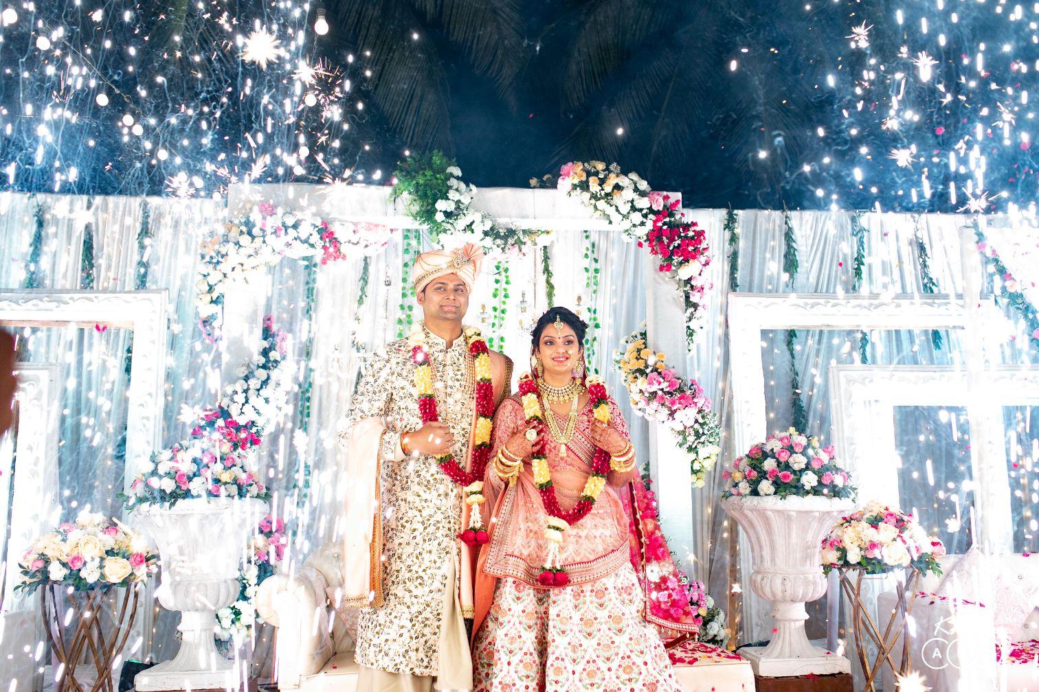 Bride & Groom Varmala Ceremony and White Frames & Colorful Flowers Decor