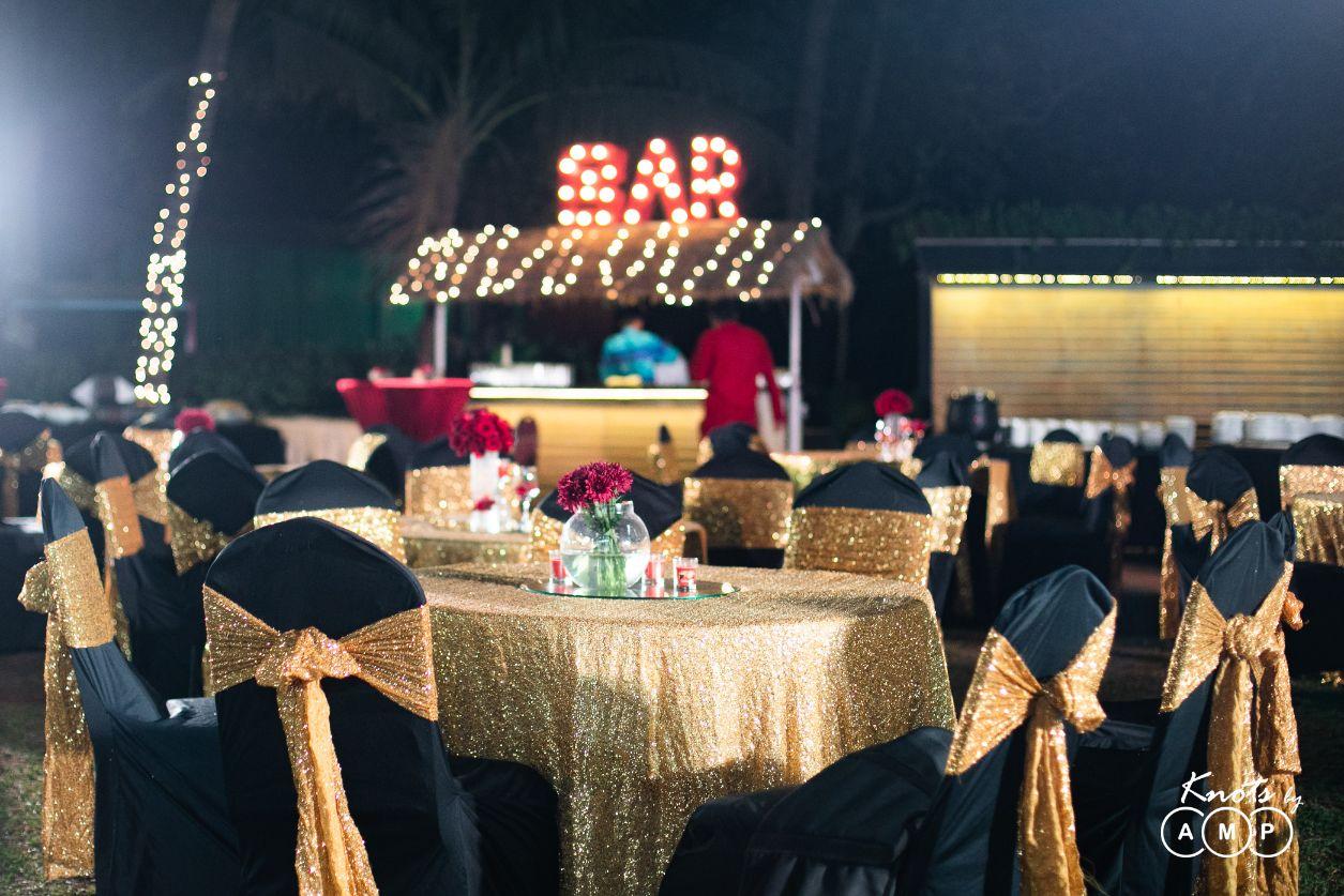 Black & Glittery Golden Seating Setup