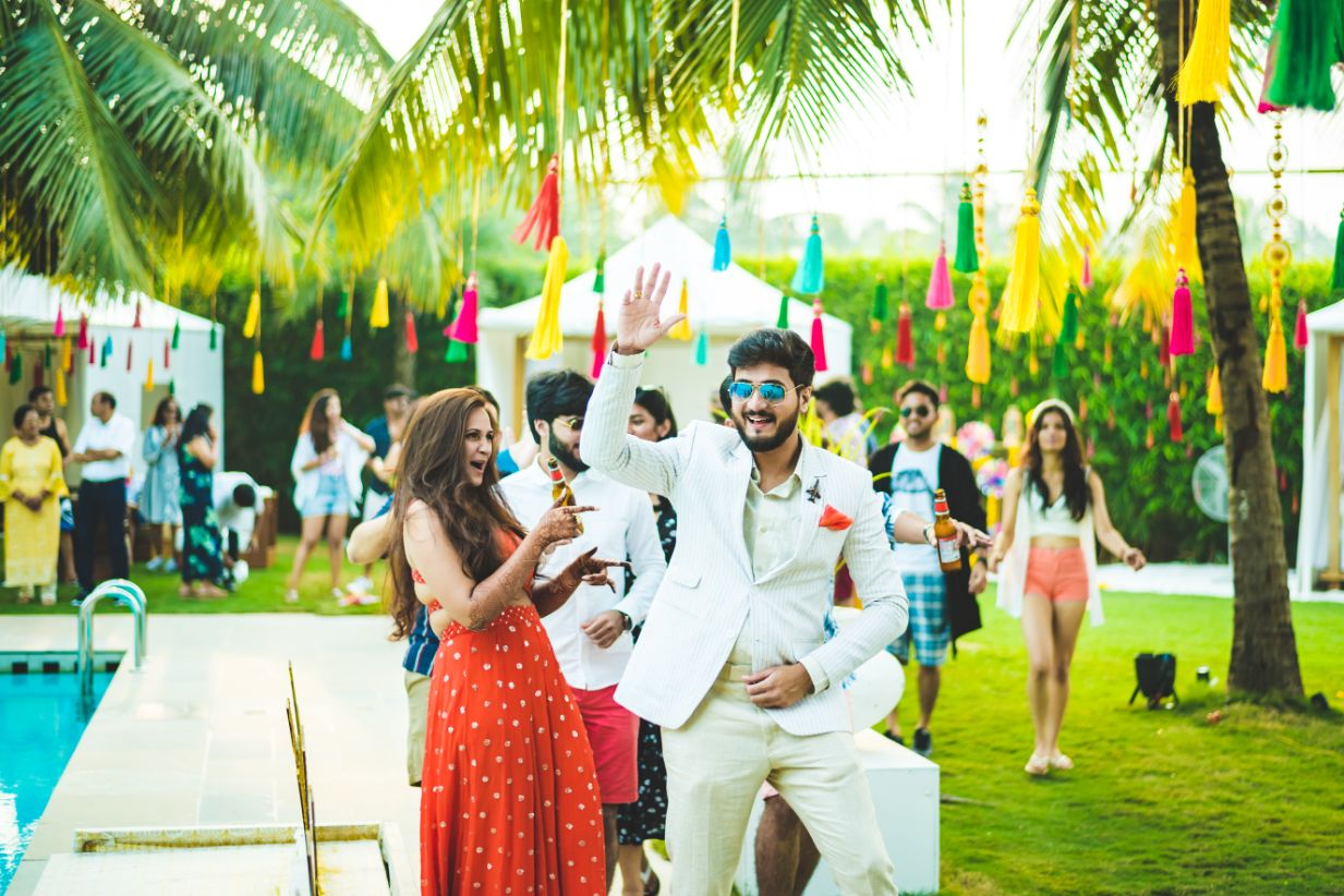 Colorful Tassels Decor and Dancing Groom and Friends