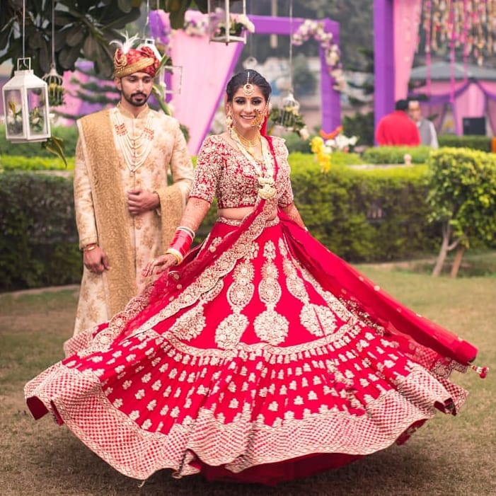 Bride Twirling her Lehenga