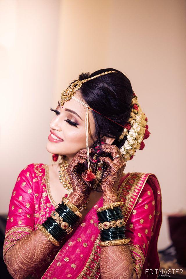 Beautiful Maharashtrian Bride in Pink Lehenga Getting Ready For Wedding