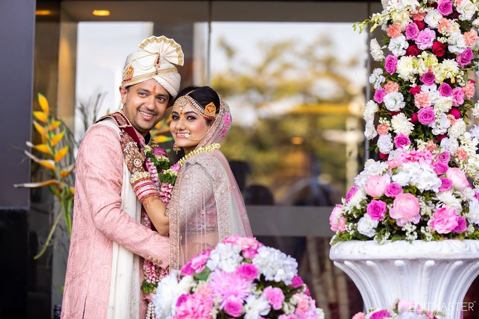 Bride & Groom in Coordinating Pink Wedding Outfits Post Indian Wedding Picture