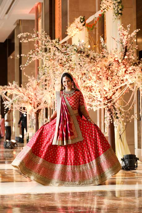 Smiling and Twirling Bride in Red