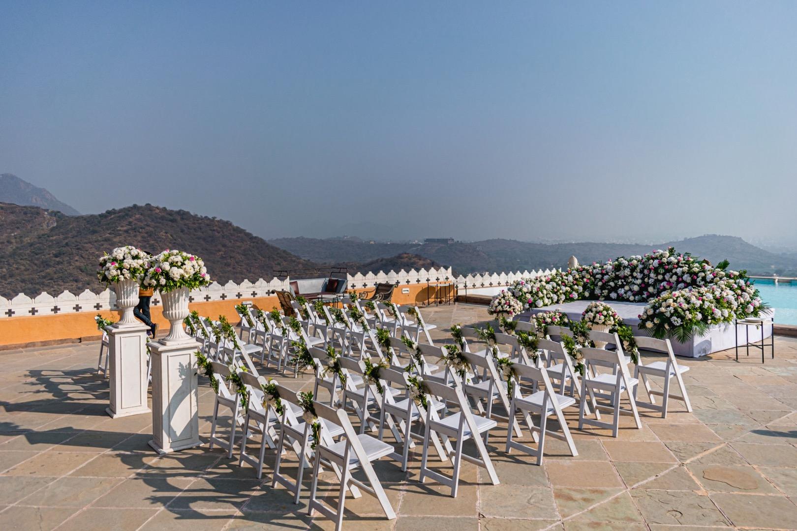 white wedding décor with mountains as backdrop