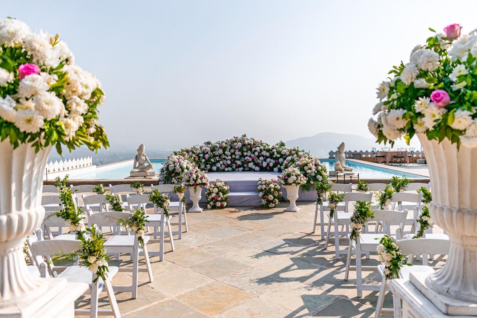 white pool wedding décor