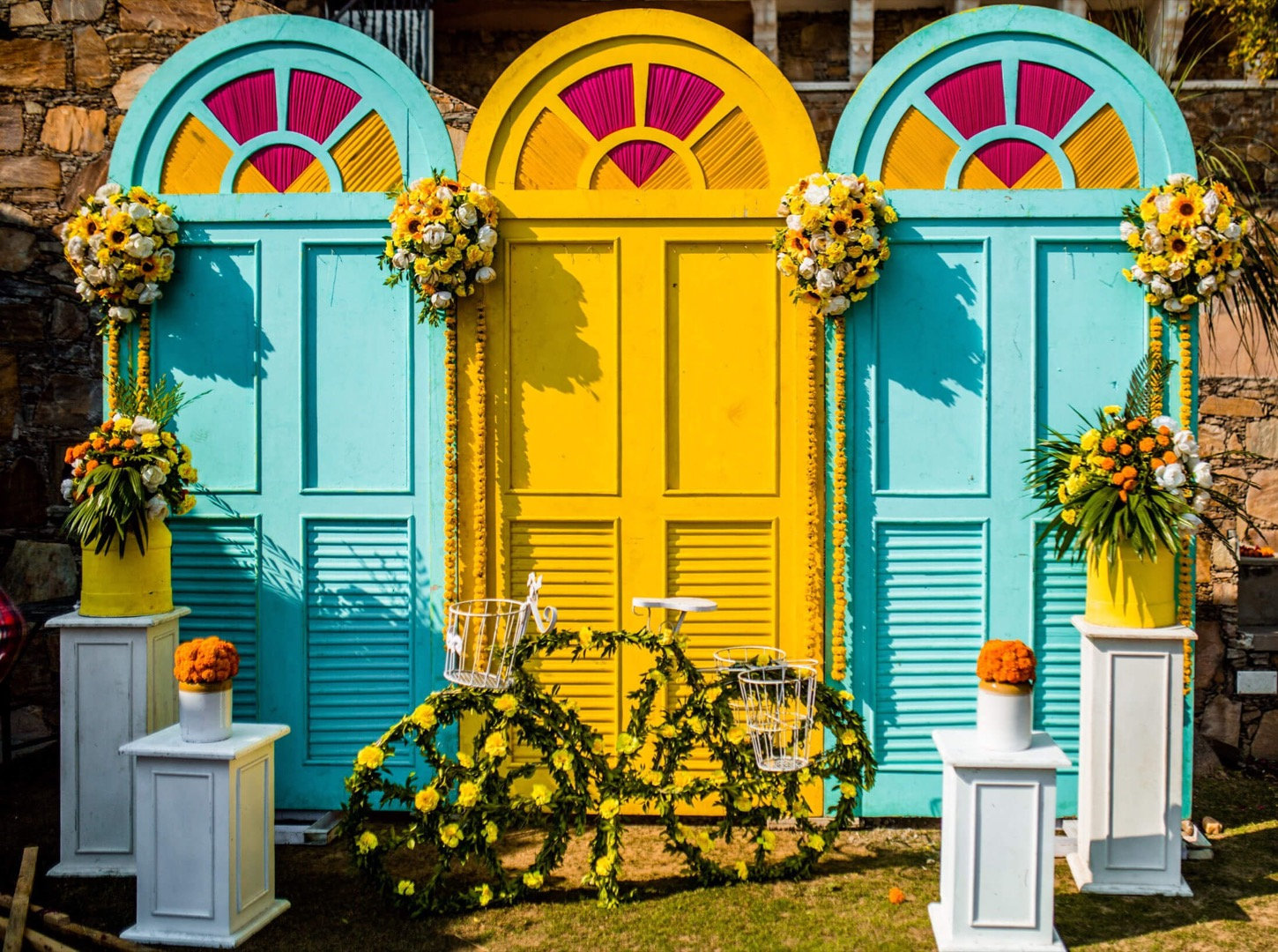 vibrant décor in aqua blue and yellow with cycle and doors