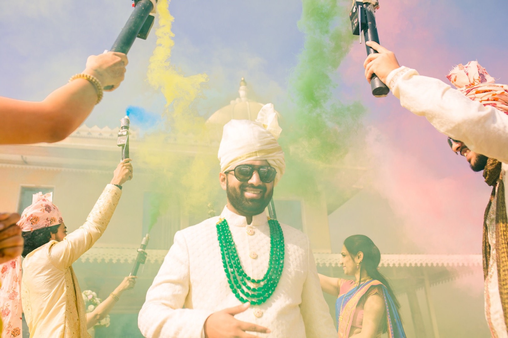 groom entering with color bombs
