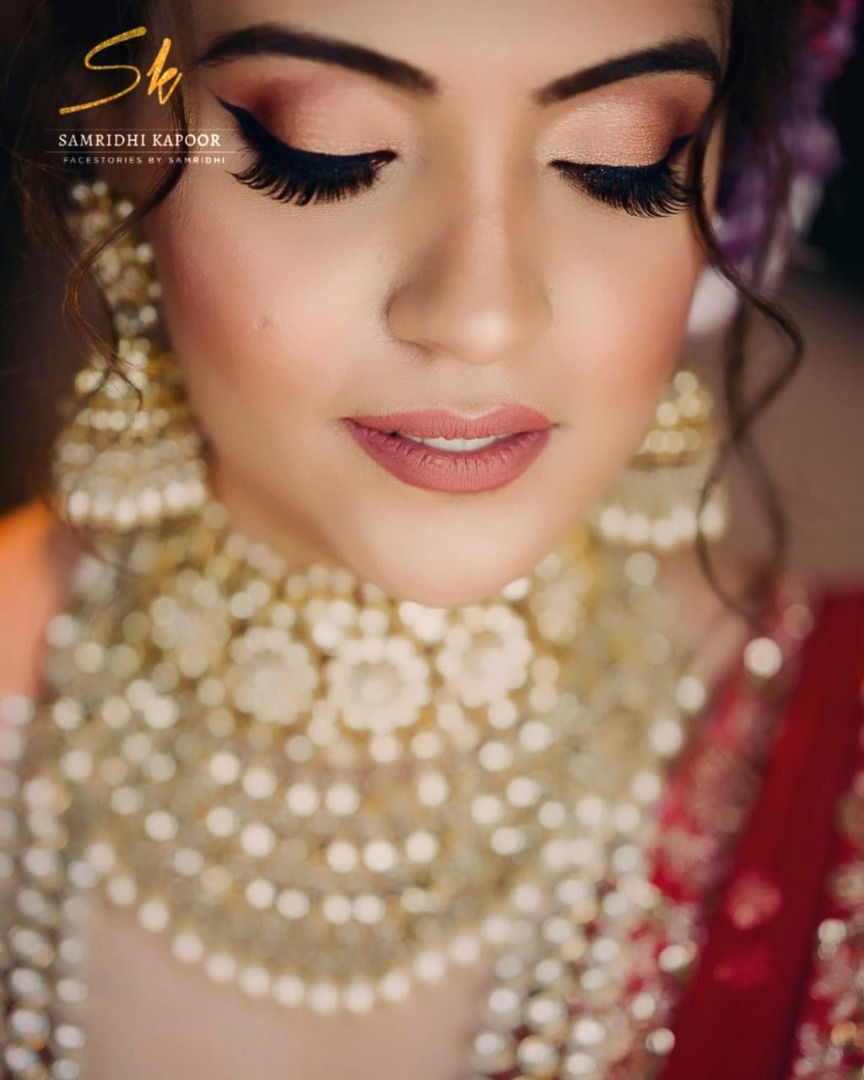 bride in gold bridal makeup and heavy jewellery
