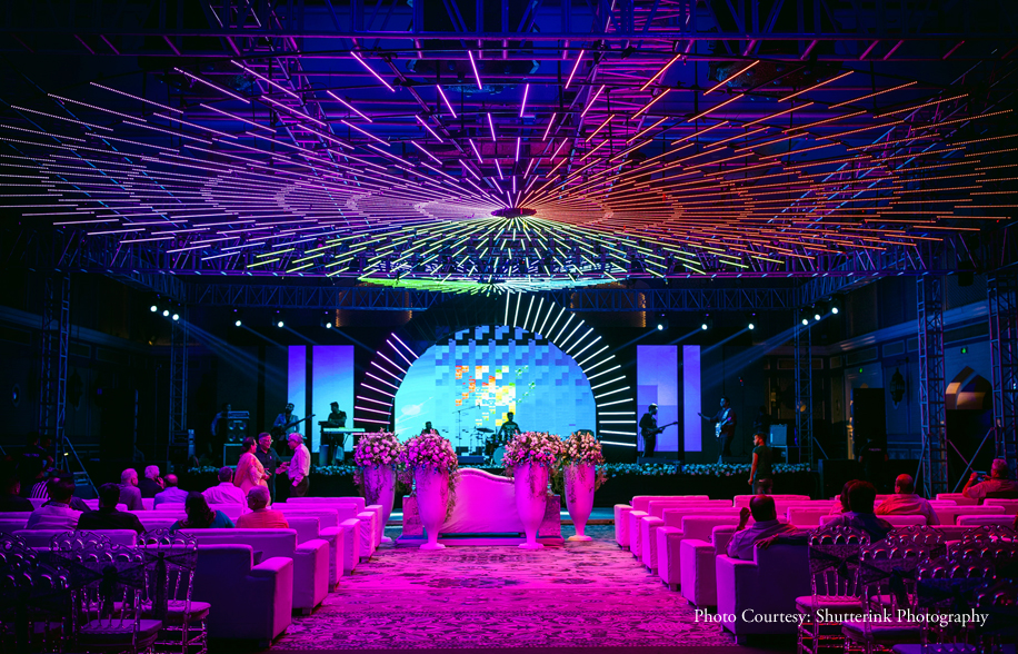 Indoor Sangeet Ceremony Decor with Lighted Ceiling and White Flowers
