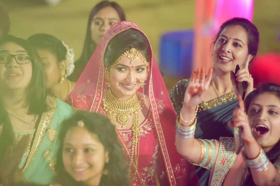 Bride entering while her Bridesmaids Dancing