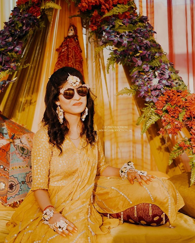 Stylish Bride in Yellow Outfit and flower jewelry for Haldi Ceremony