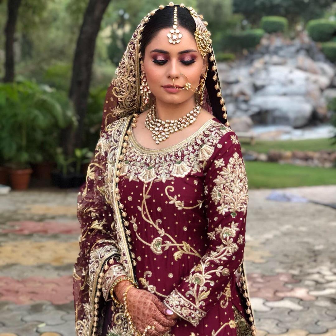 bride in heavy maroon bridal lehenga
