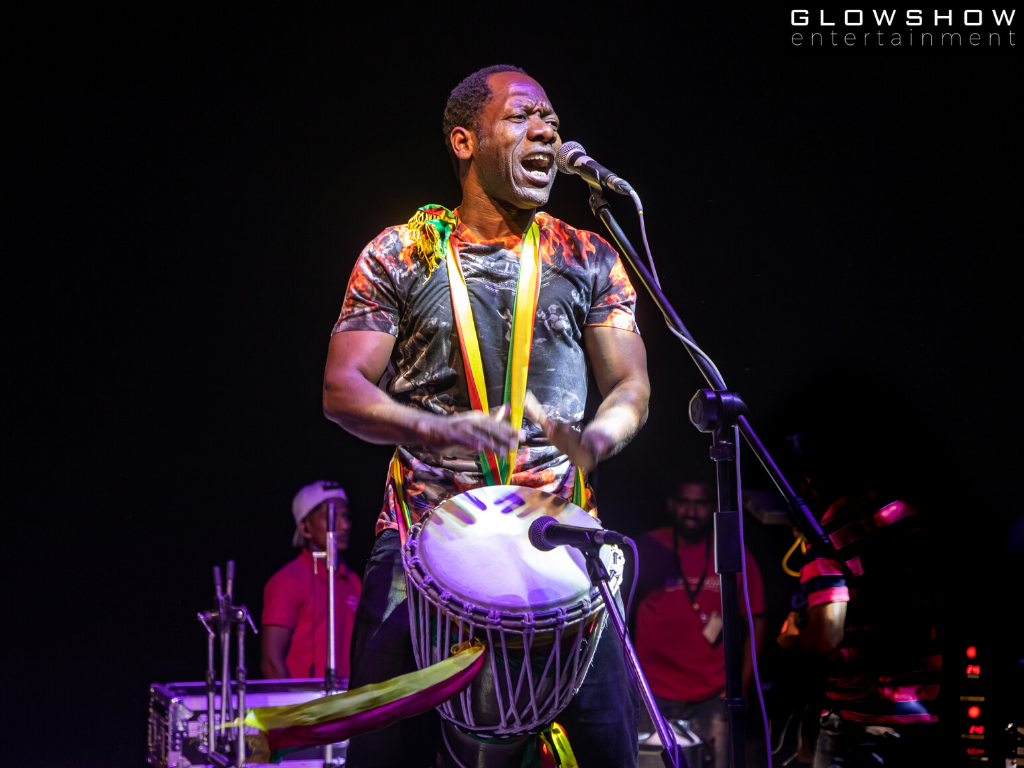 singer performing with drum