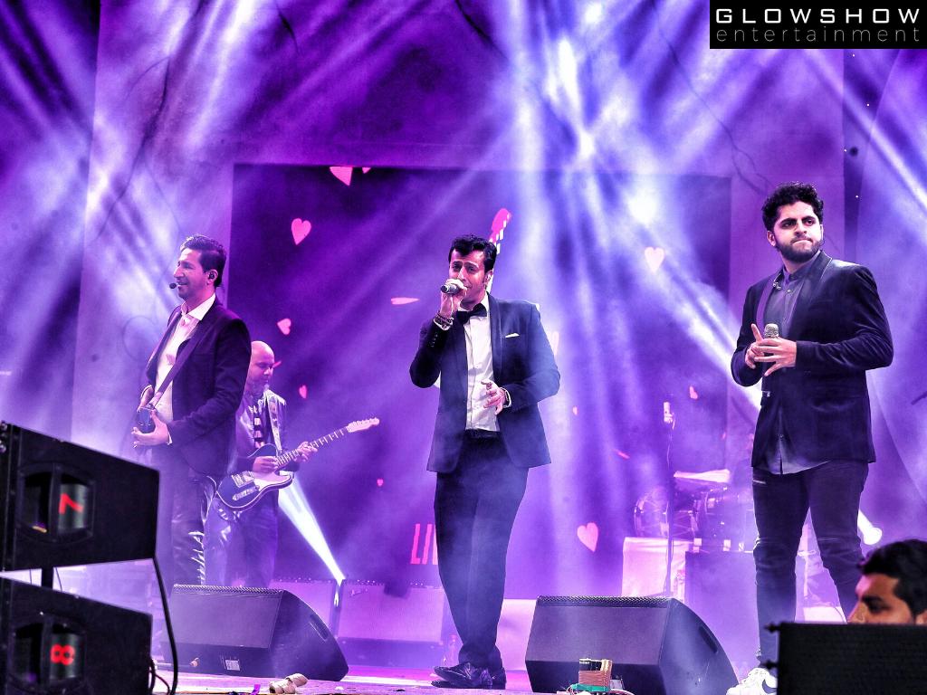 Salim Suleiman performing in black suits