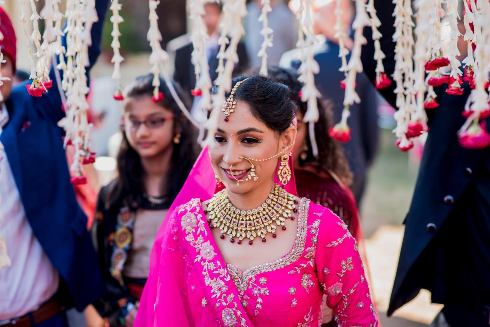 bridal entry under floral chhatri
