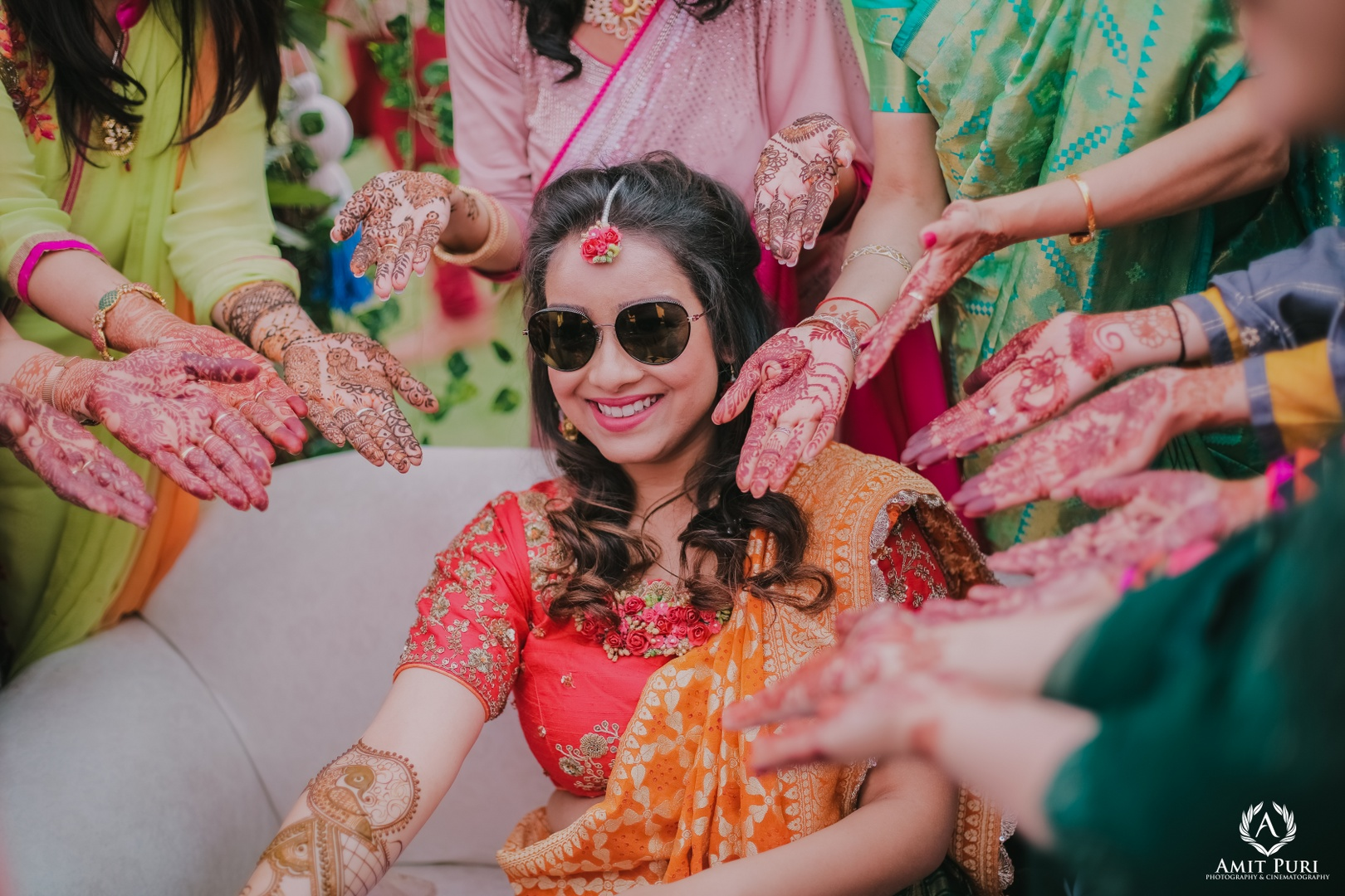 bride poses with her girl gang at her mehendi