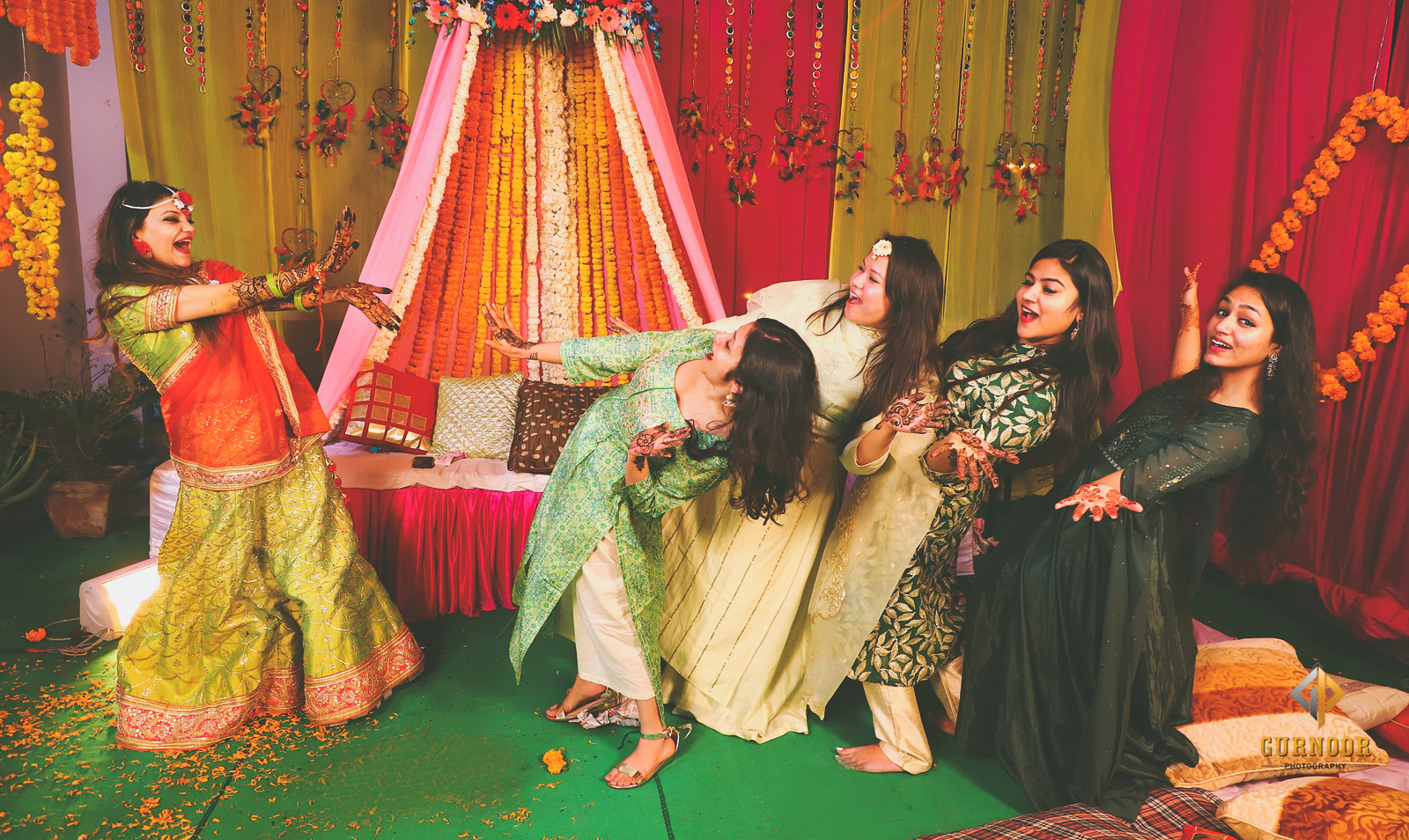 Candid Mehendi Photography of Bride with her Bridesmaids