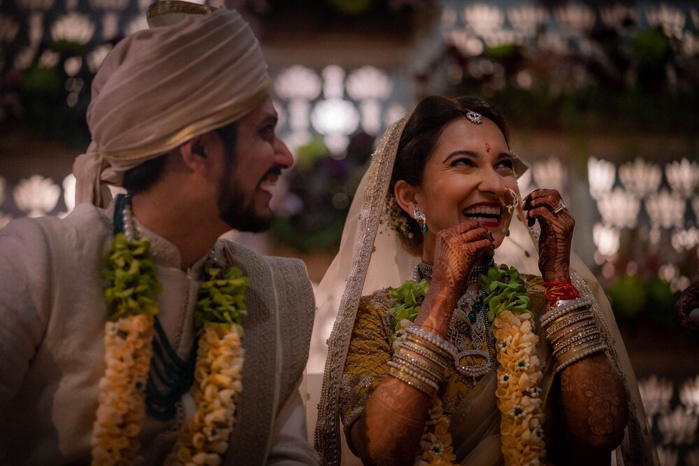 Laughing Indian Bride & Groom During Wedding in Co-ordinated Yellow Outfits