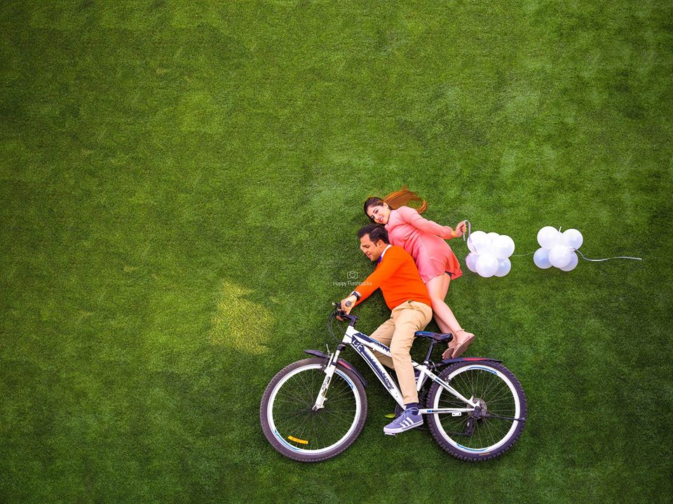 Funny & Illusionist Pre Wedding Picture on a Cycle with Balloons