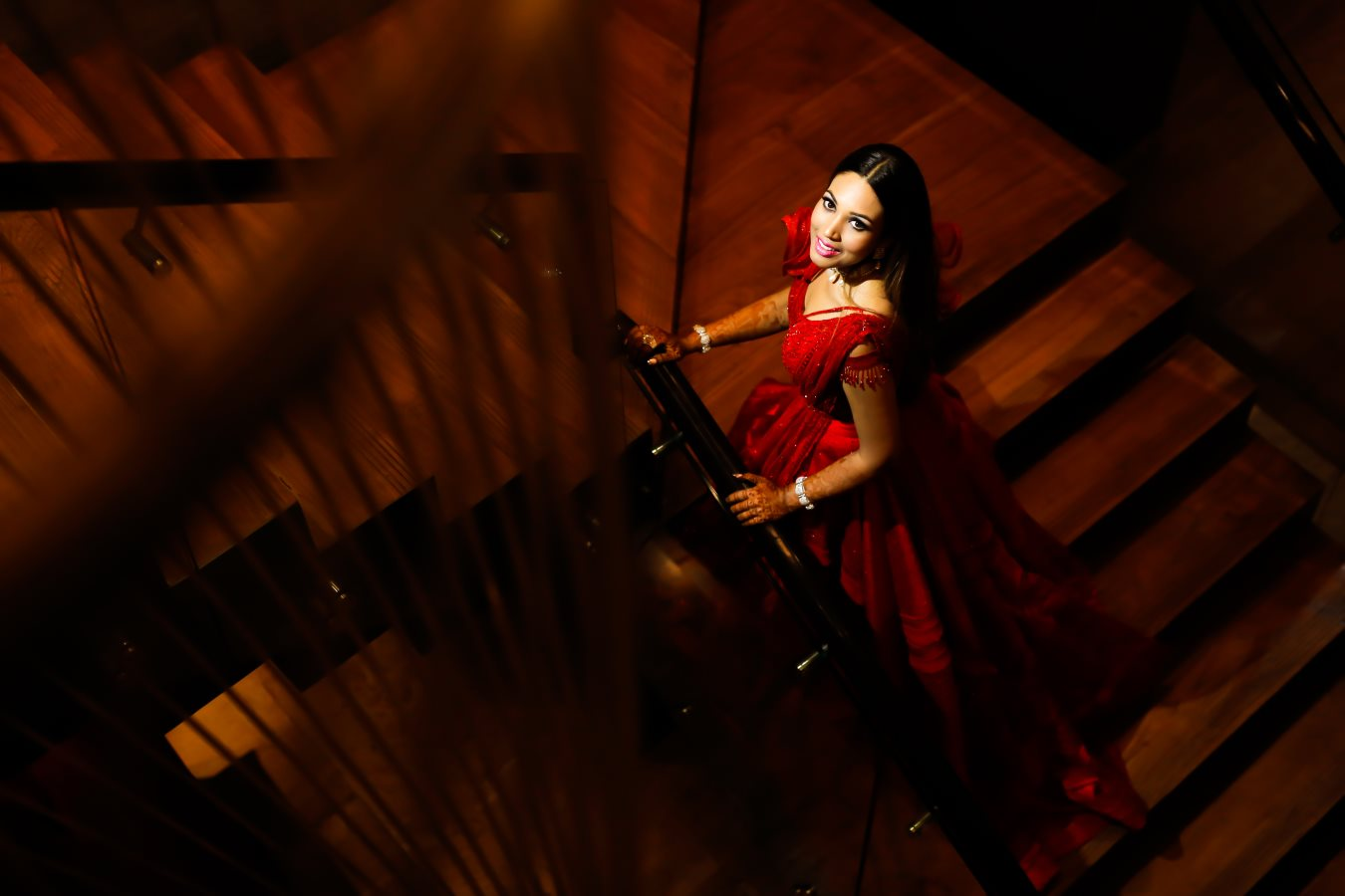 Bridal Solo Shot in Red Gown on Stairs