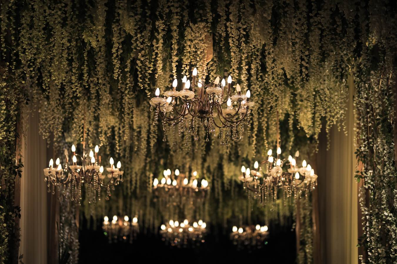 Grand Chandelier and Cascading Greens Ceiling Decor