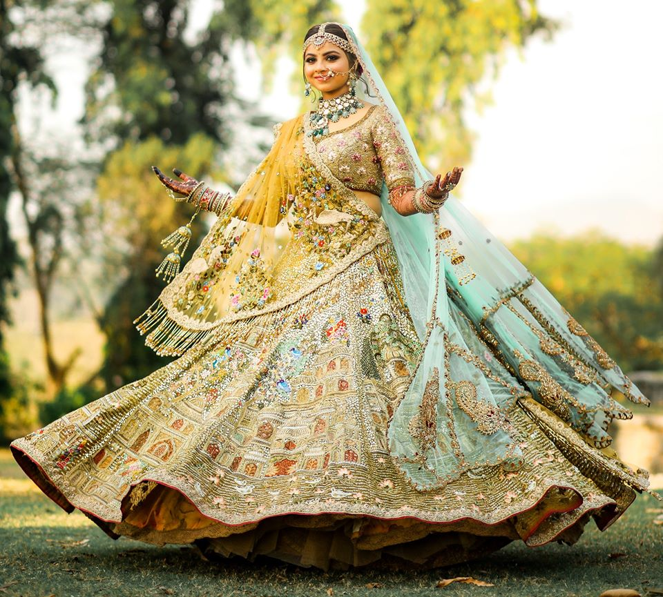 Twirling Bride in Pastel Blue & Green Wedding Lehenga