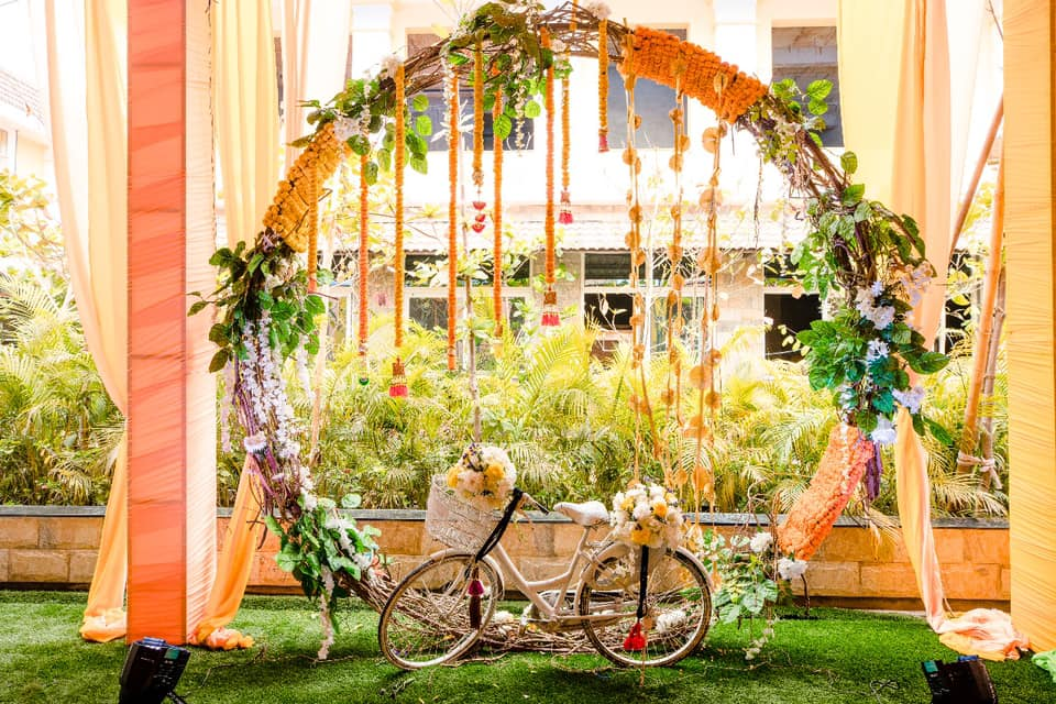 Floral Arch and Cycle Prop Haldi Ceremony Decor