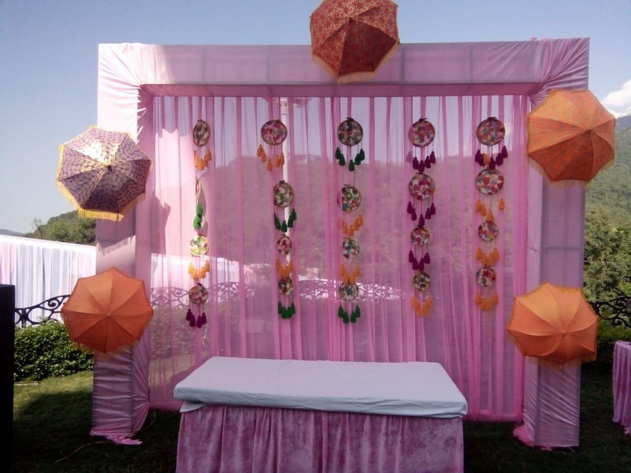 pink decor with orange umbrellas