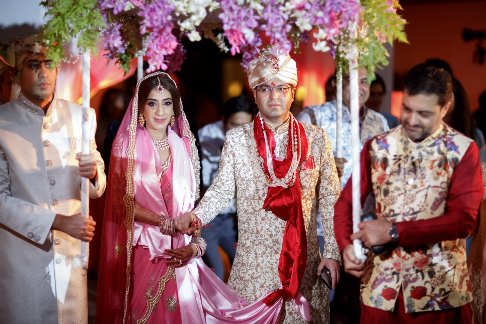 Beautiful Indian bride and groom with family during pheras