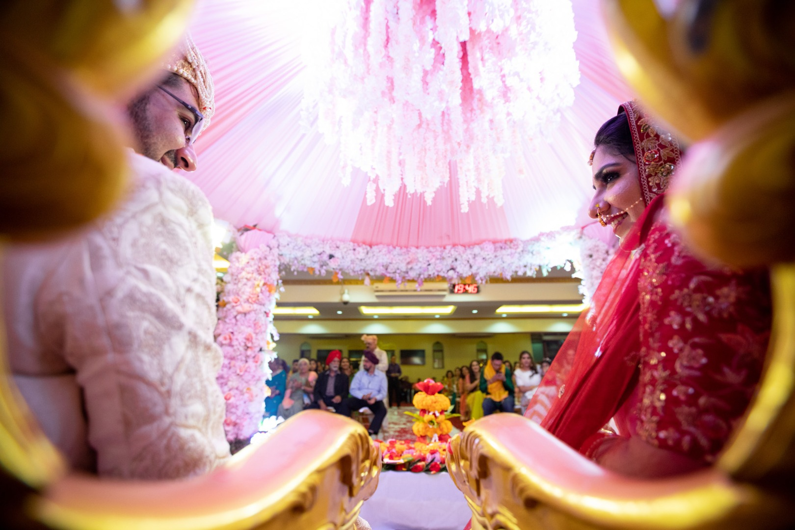 Candid moment between bride and groom during the vermala