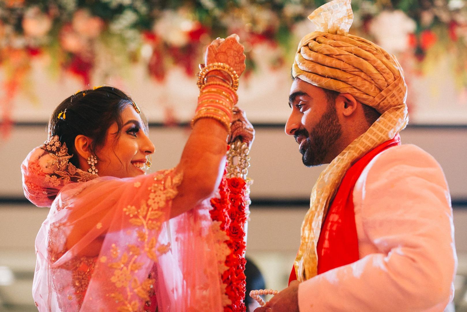 Bride & Groom During Indian Wedding Jaimala Ritual