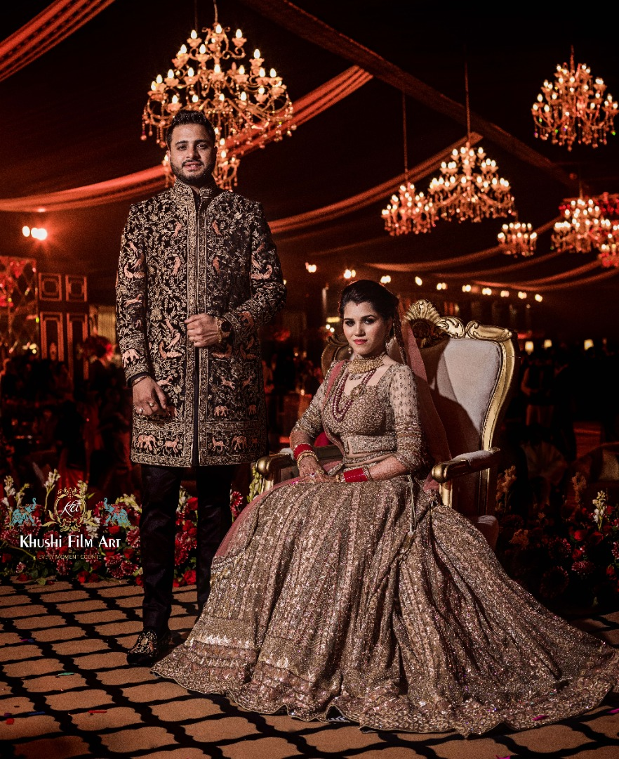couple in coordinated outfits at their wedding