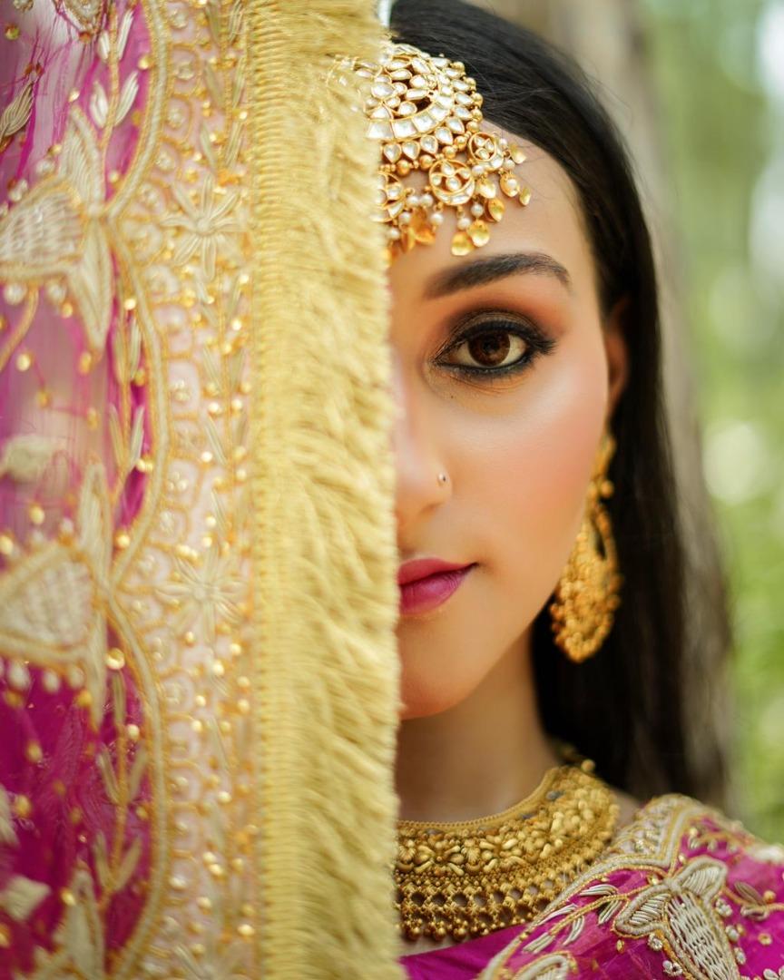 punjabi bride in deep kohled eye makeup