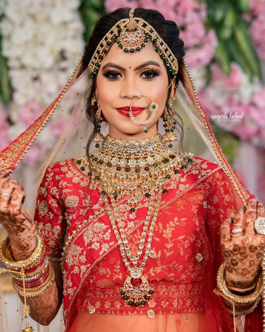 gorgeous bride in red bridal lehenga