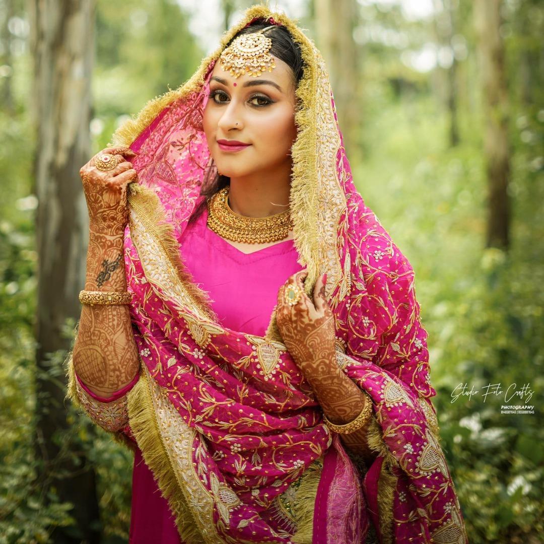 punjabi bride in pink suit