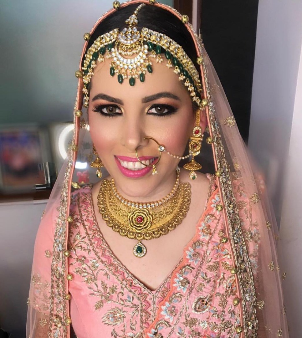 bride in pink bridal lehnga with pink natural makeup