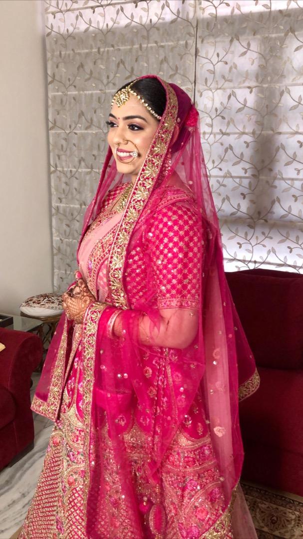 Beautiful Indian Bride with Natural Makeup in Pink Lehenga