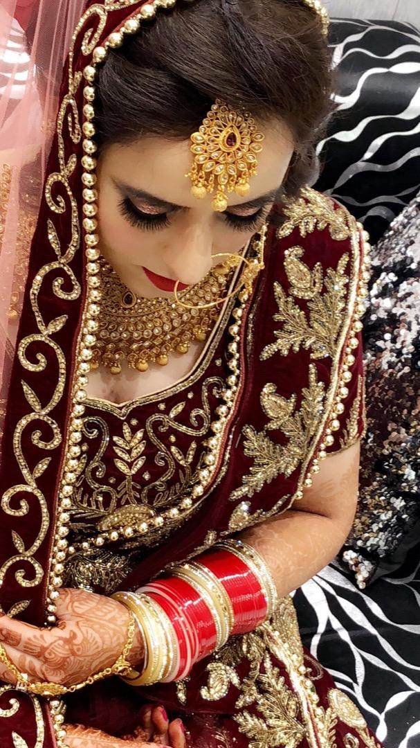 Bride in Maroon Lehenga and Matching Makeup