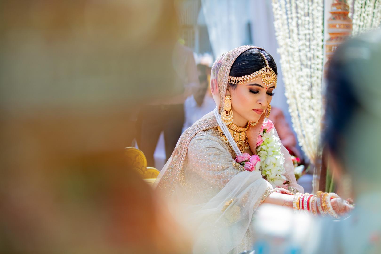bride in pastel lehnga and natural bridal makeup