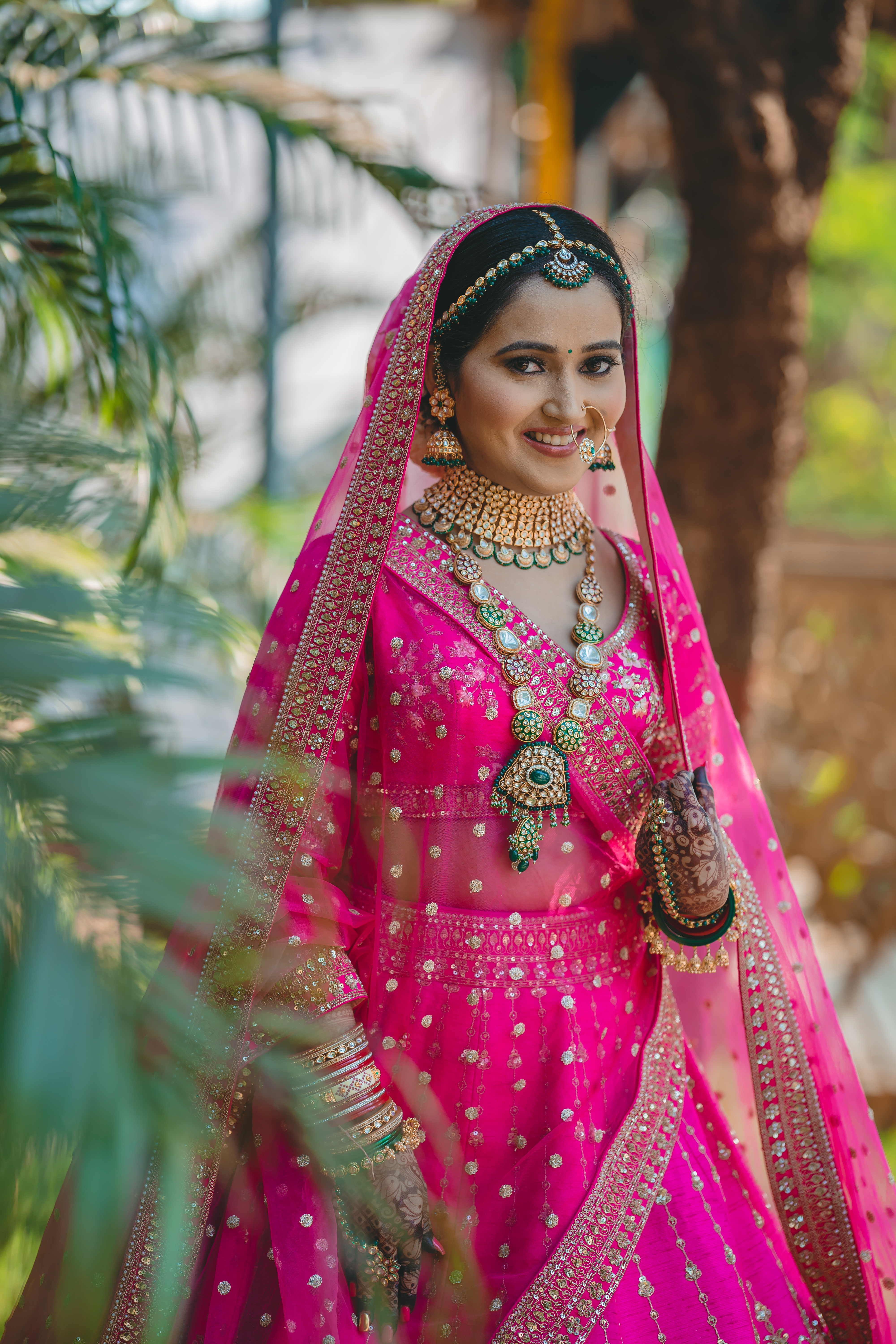 bride in pink bridal lehenga with contrast jewellery