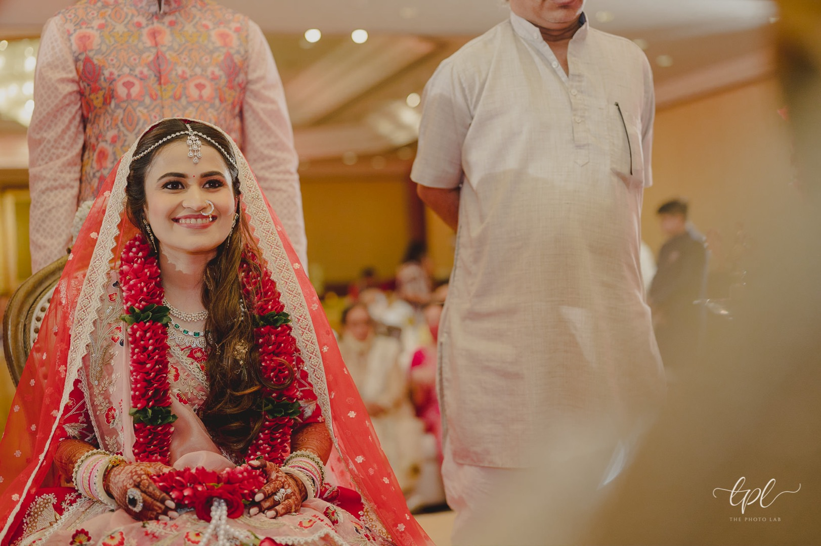 bride in red with open hairstyle