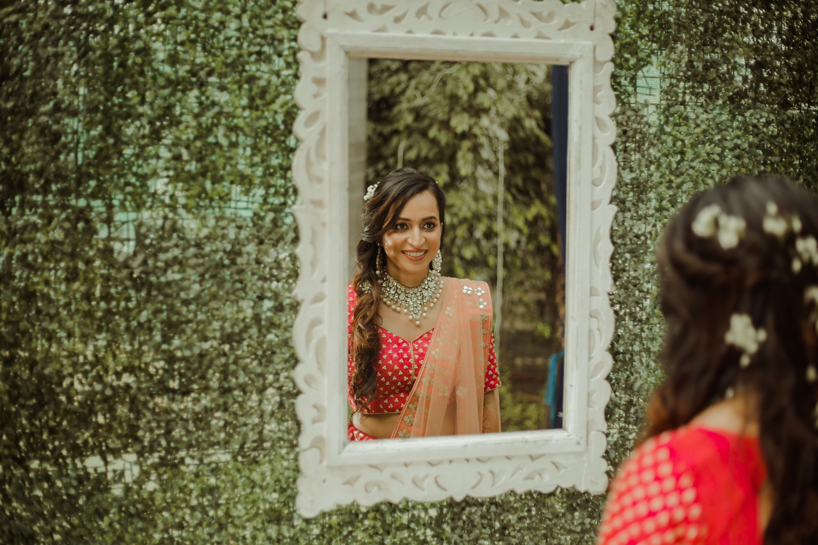 Mirror capture of the bride in pre-bridal photoshoot