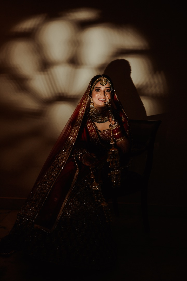 Beautiful bride in red with light falling on her face
