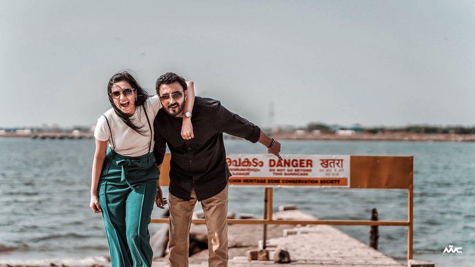 Fun Couple Pre Wedding Photoshoot Near the Sea