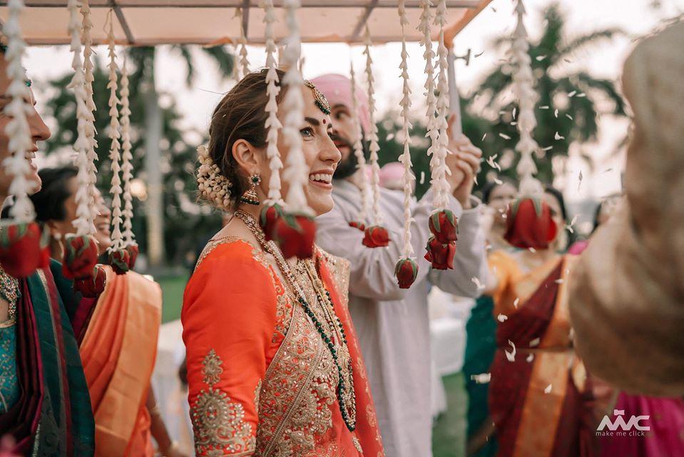 Smiling Bride Entry under Phoolon Ki Chaadar