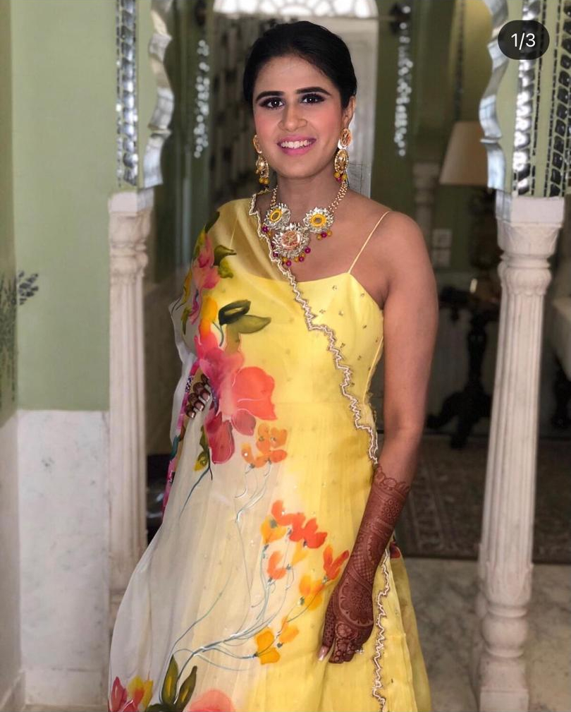 bride in yellow at her pre wedding rituals