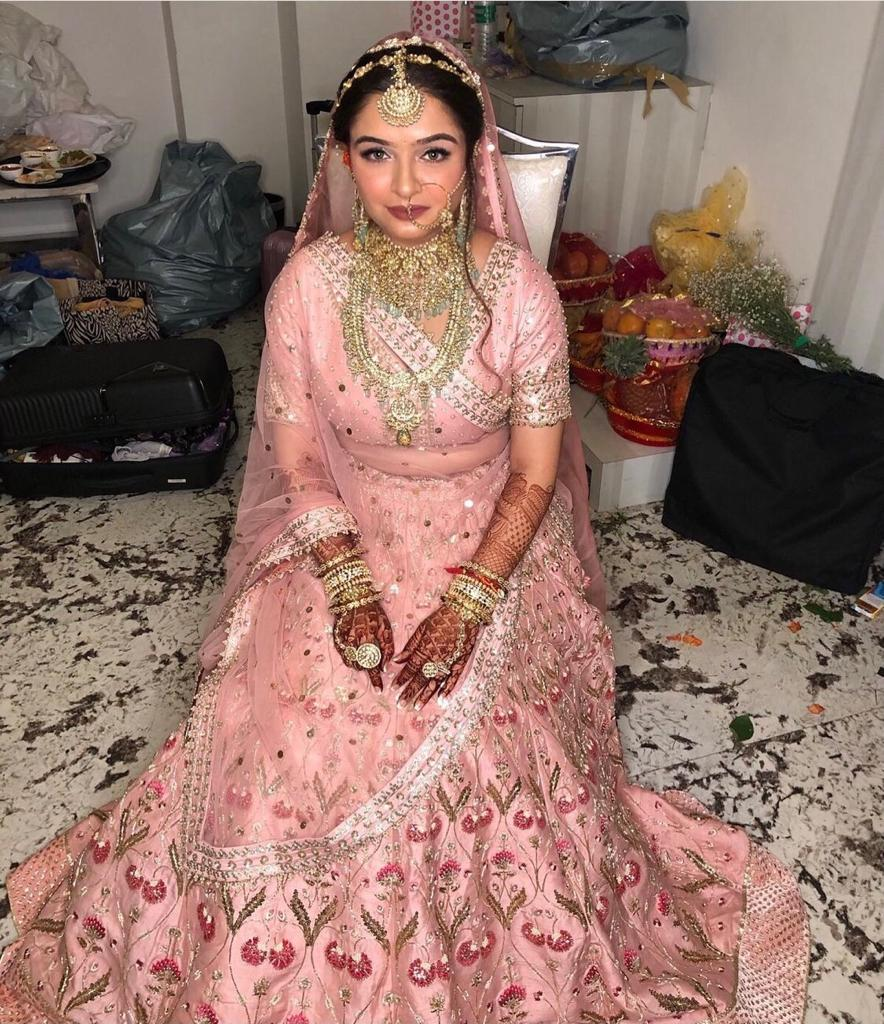 bride in pastel pink lehnga