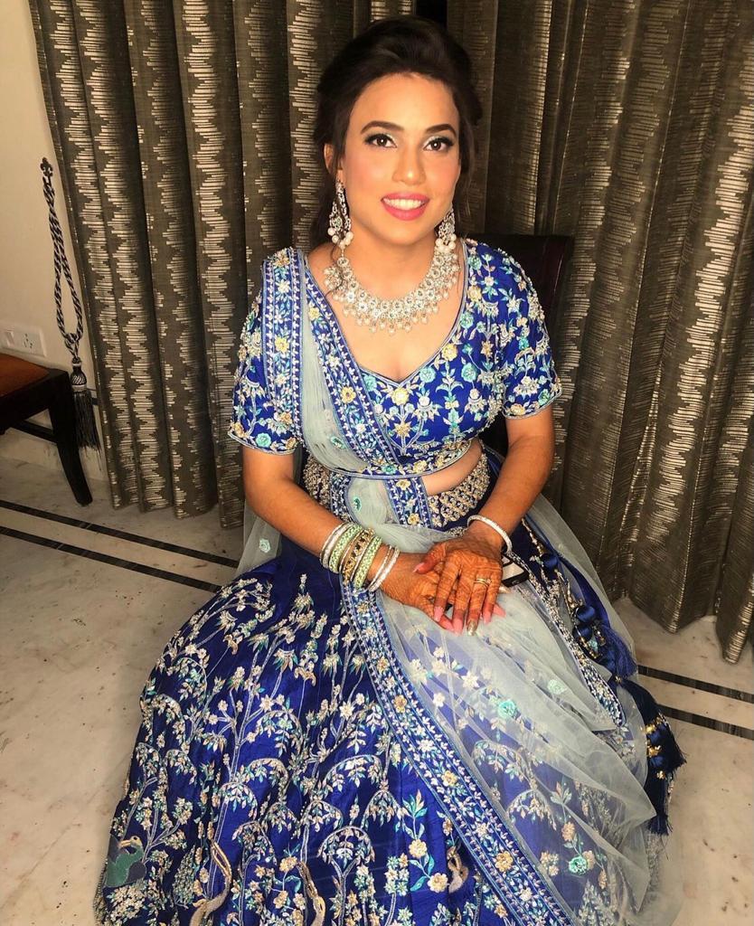 bride in blue Lehnga