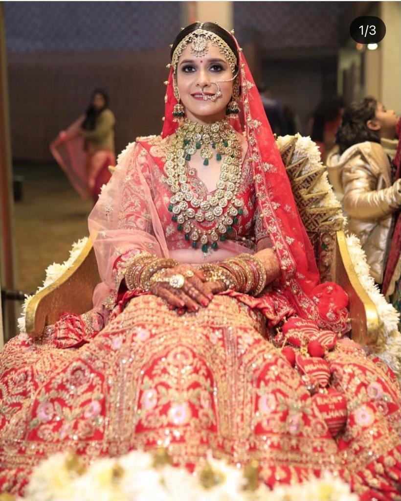 bride in heavy red bridal lehenga
